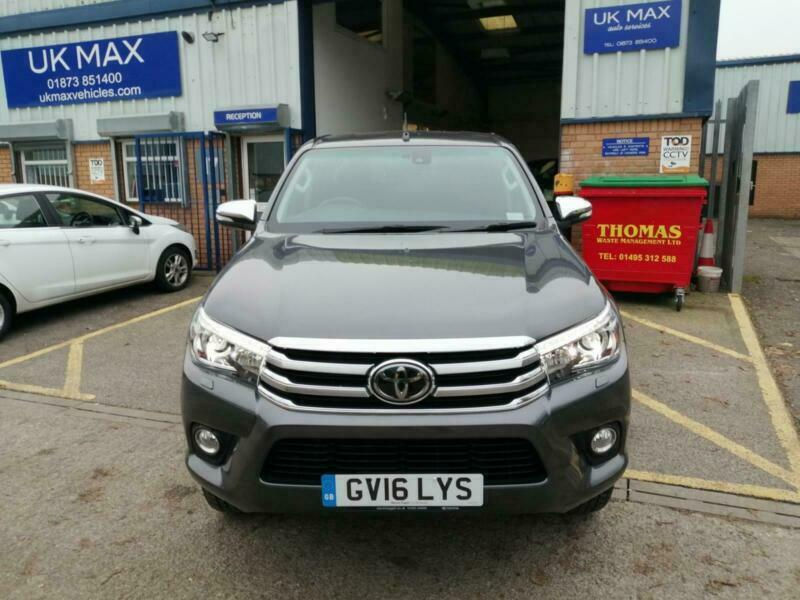 2016 Toyota Hilux Invincible D Cab Pick Up 2.4 D 4D Auto Double Cab  NO VAT ON THIS HILUX INVINCIBLE. With factory mud flaps all round, side steps and factory cargo lining, this is a proper, rugged truck. Being an auto, it is a pleasure to drive, and with a mere 21,568 miles on the clock and a full service history, has many years of Toyota reliability ahead of it. Being the Invincible, it comes as standard with all the essential kit such as large touch screen sat nav, climate control, cruise control, electric heated, folding and adjustable wing mirrors, reverse camera and headlight washers. In great condition and all ready to drive away today.
